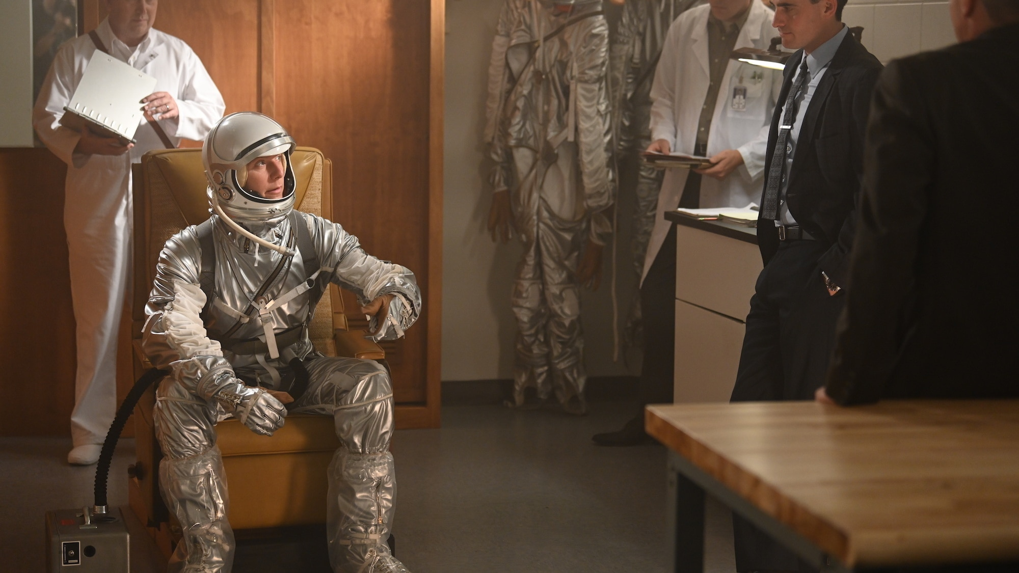 Jake McDorman as Alan Shepard (seated) talking to Colin O'Donoghue as Gordon Cooper (R) in National Geographic's THE RIGHT STUFF streaming on Disney+. (Credit: National Geographic/Gene Page)