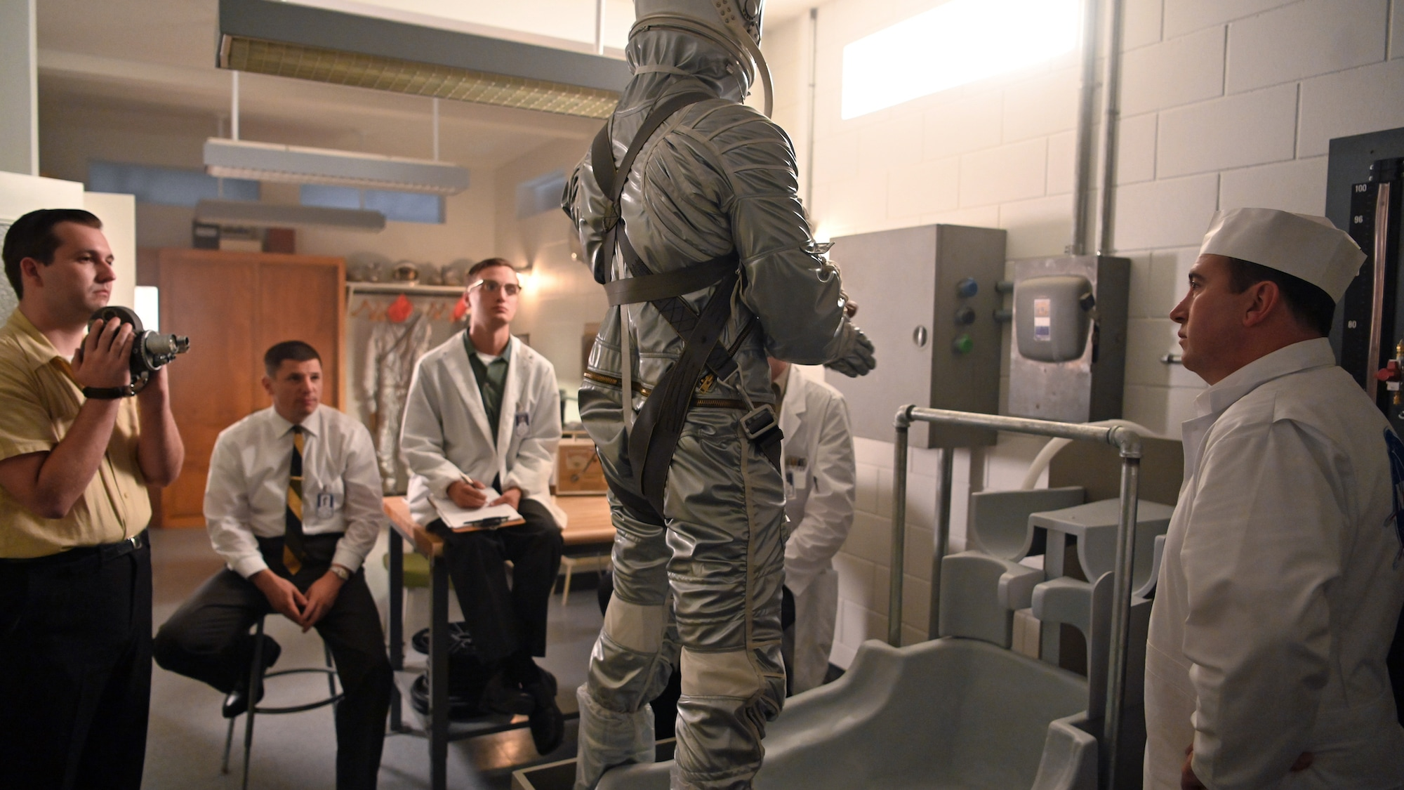 Alan Shepard (standing center), played by Jake McDorman, in space suit in National Geographic's THE RIGHT STUFF streaming on Disney+. (National Geographic/Gene Page)