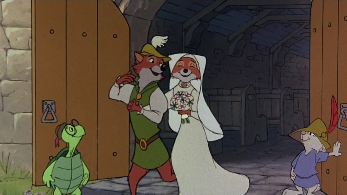 Robin Hood and Maid Marian leaving the wedding chapel