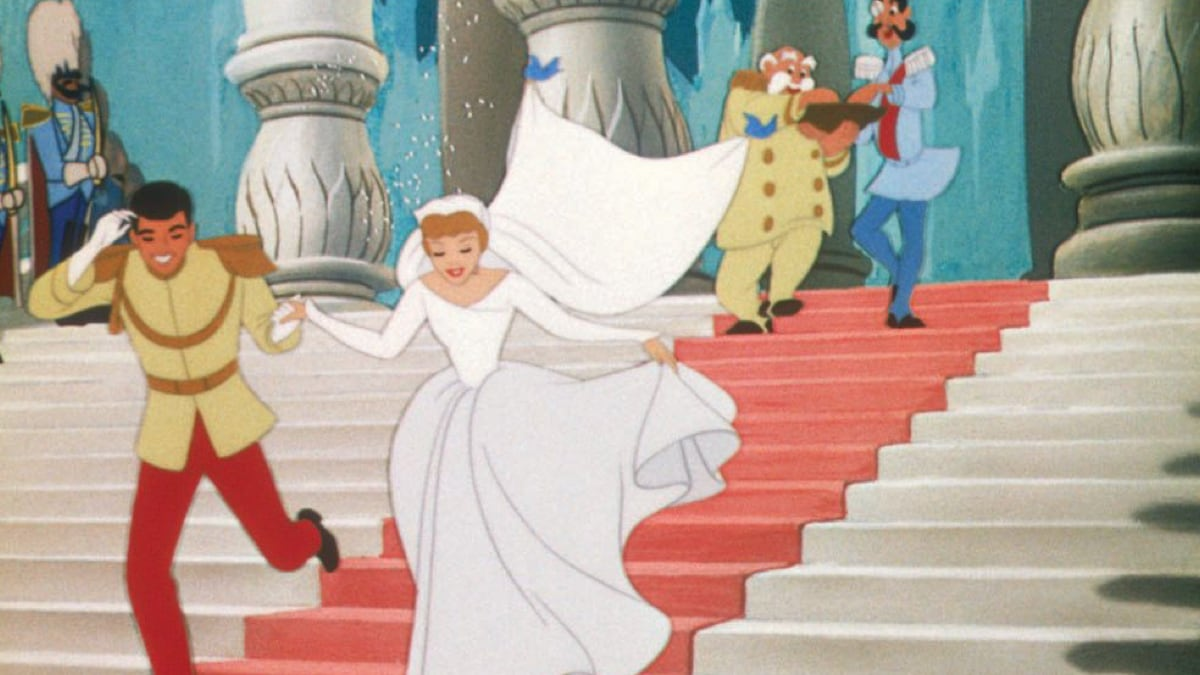 Cinderella and Prince Charming running down the stairs after getting married