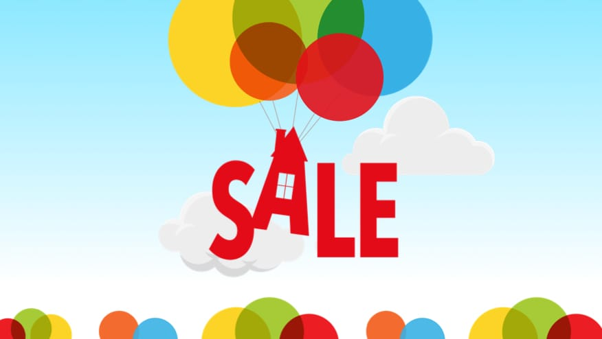 The word sale attached to balloons, floating in the sky