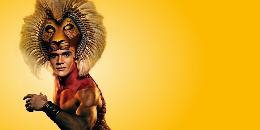 A performer in costume as Simba
