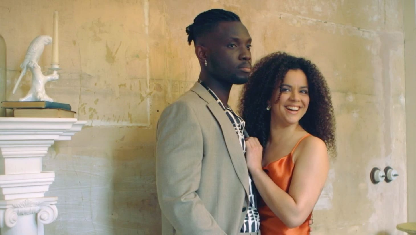 Actors Emmanuel Kojo and Courtney Stapleton posing together for a photoshoot