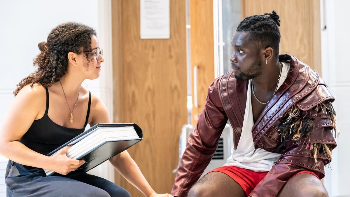 Emmanuel Kojo and Courtney Stapleton rehearsing as Beast and Belle holding hands and looking in each others eyes