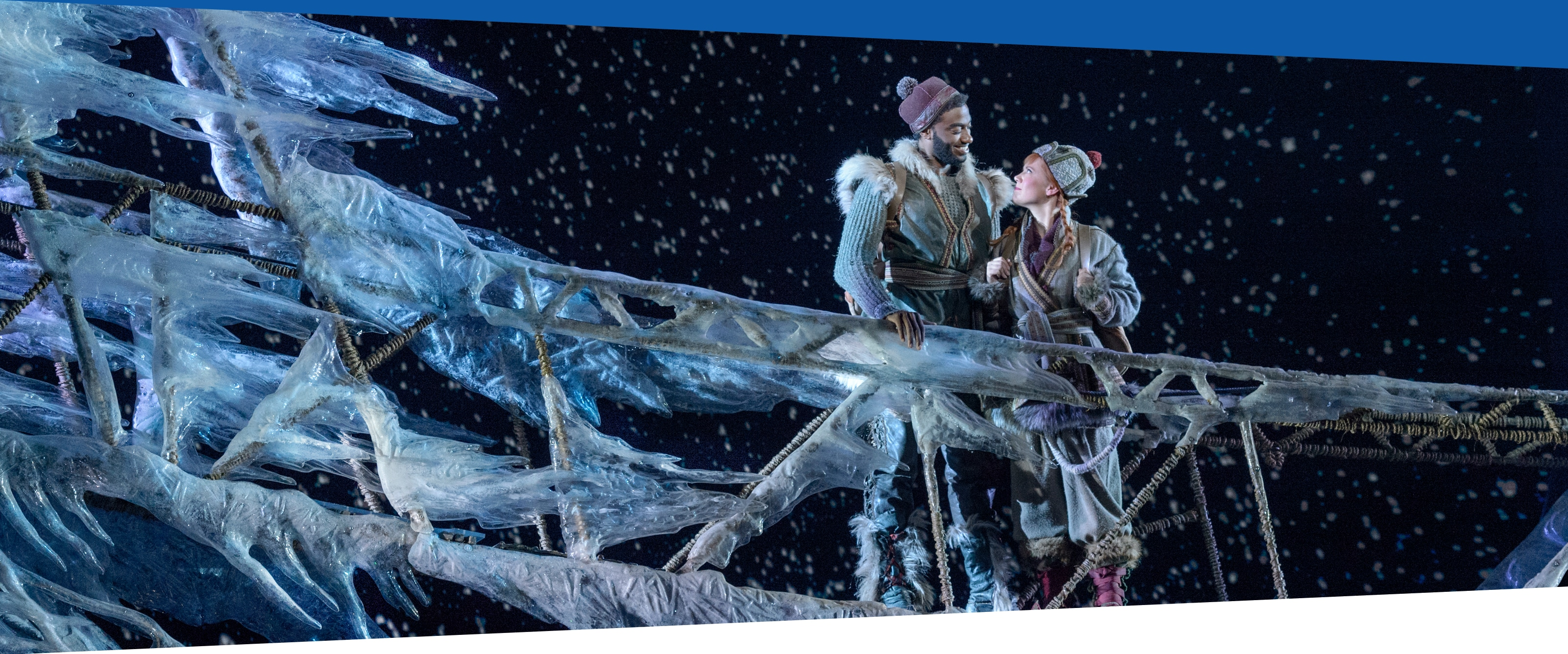Kristoff and Anna walking across a bridge of ice
