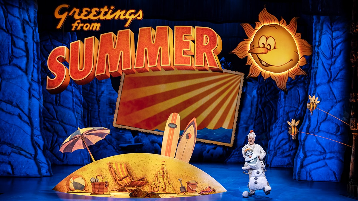 Olaf next to a summer recreation with a small beach and a smiling sun.