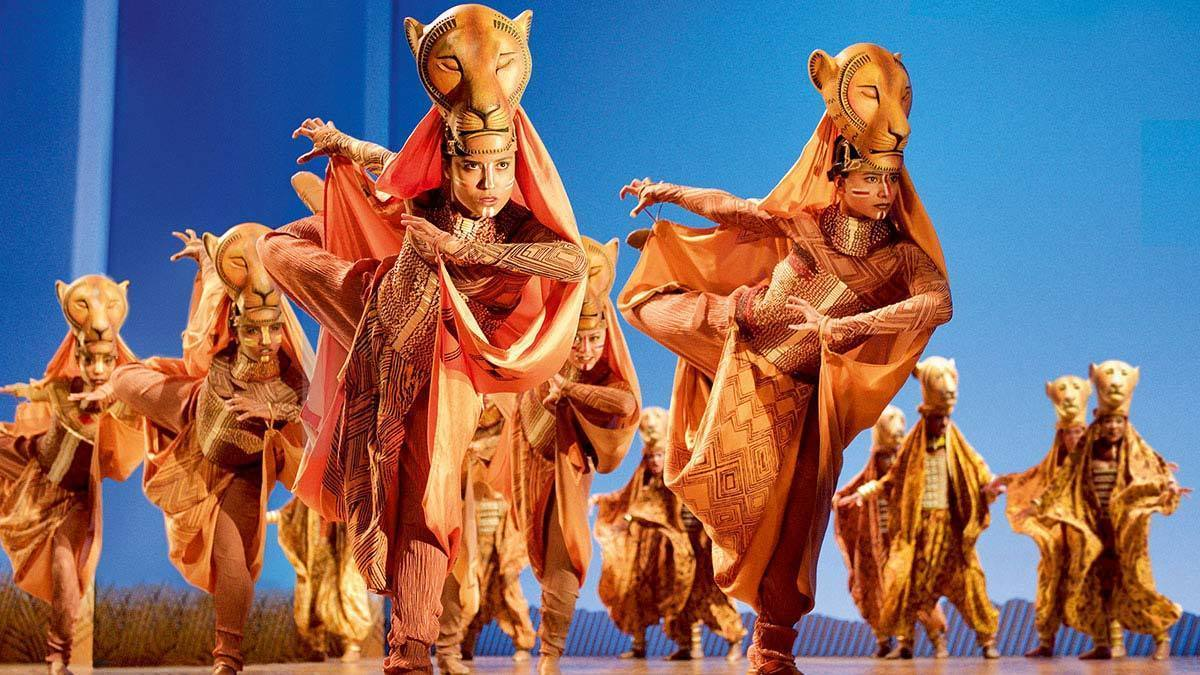 Actors posing as lionesses in the stage show The Lion King