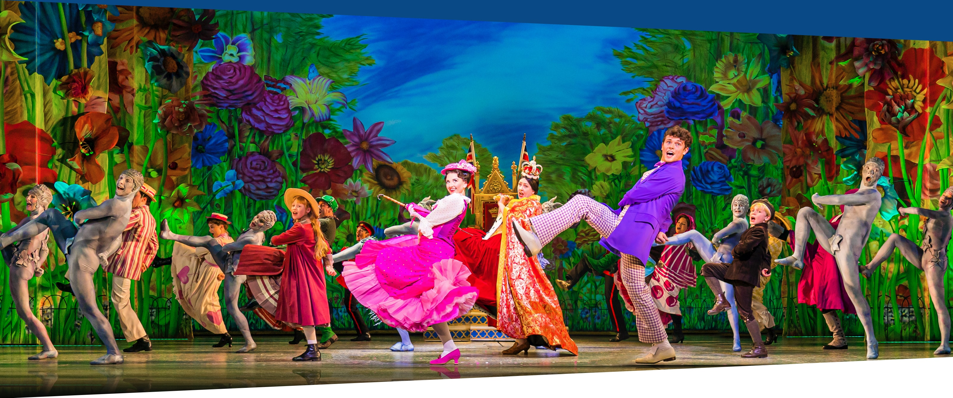 Actors dancing on stage in Mary Poppins the Musical