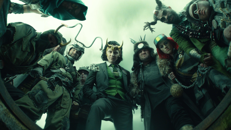 (Center): President Loki (Tom Hiddleston) in Marvel Studios' LOKI, exclusively on Disney+. Photo courtesy of Marvel Studios. ©Marvel Studios 2021. All Rights Reserved.