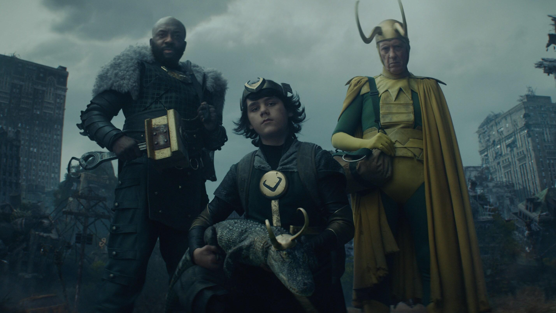 (L-R): Boastful Loki (DeObia Oparei), Kid Loki (Jack Veal), Alligator Loki and Classic Loki (Richard E. Grant) in Marvel Studios' LOKI, exclusively on Disney+. Photo courtesy of Marvel Studios. ©Marvel Studios 2021. All Rights Reserved.