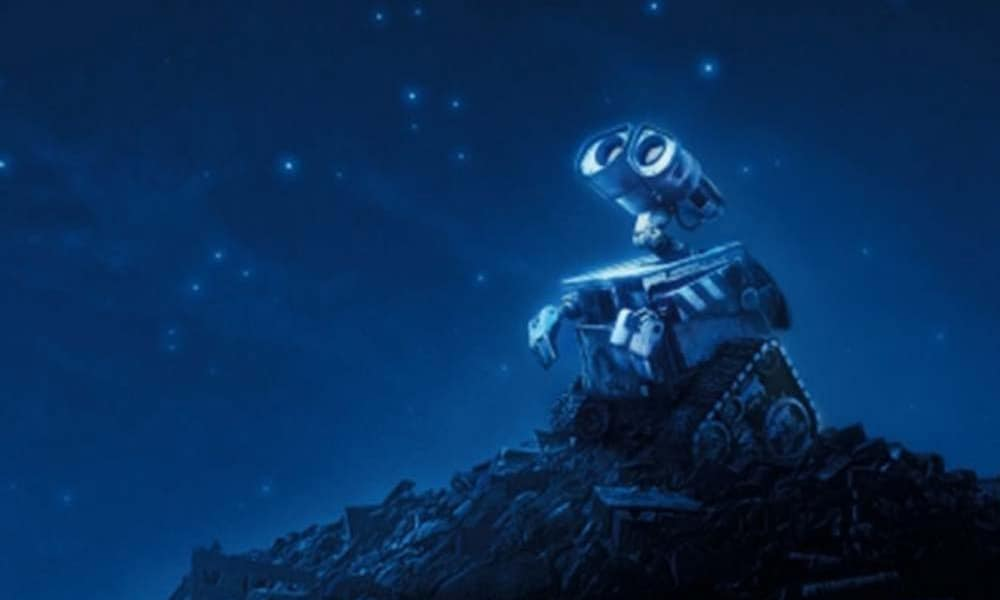 """The robot from the animated movie """"Wall-E"""" looking up at stars"""