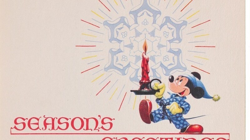 Seasons Greetings; Mickey in blue pajamas holding a large red candle