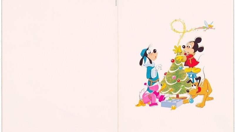 Goofy, Mickey, and Pluto decorating a Christmas tree