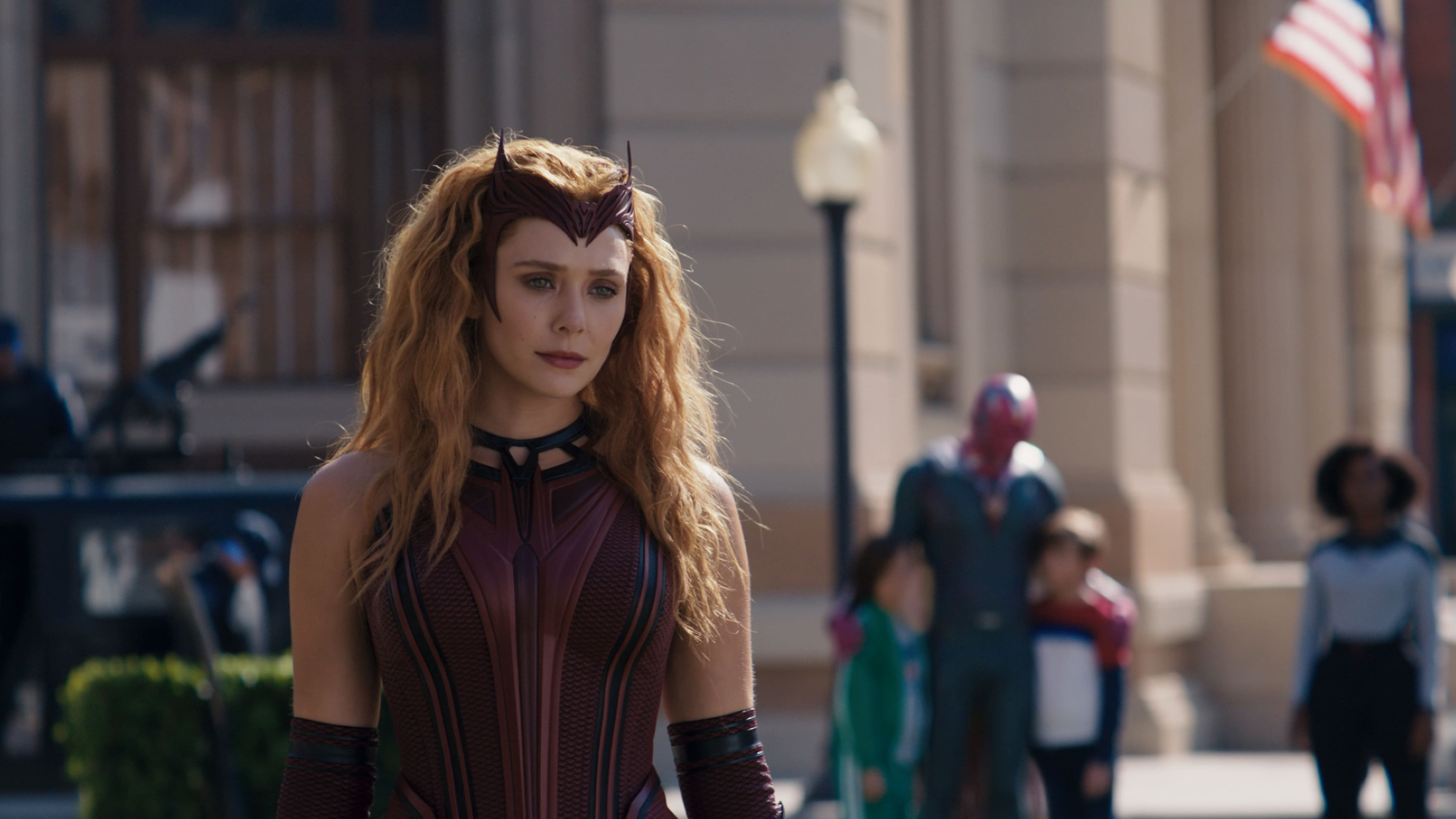 L-R): Scarlet Witch/Wanda Maximoff (Elizabeth Olsen), Tommy (Jett Klyne), Vision (Paul Bettany), Billy (Julian Hilliard) and Monica Rambeau (Teyonah Parris) in Marvel Studios' WANDAVISION exclusively on Disney+. Photo courtesy of Marvel Studios. ©Marvel Studios 2021. All Rights Reserved.