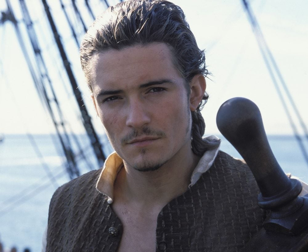 "Will Turner (played by Orlando Bloom) in the film ""Pirates of the Caribbean"""