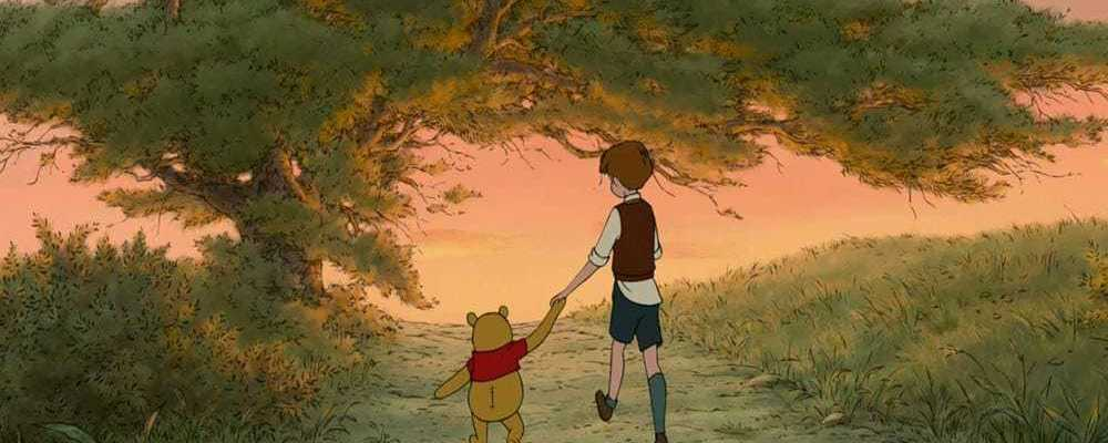 Winnie the Pooh and Christopher Robin walking while holding hands