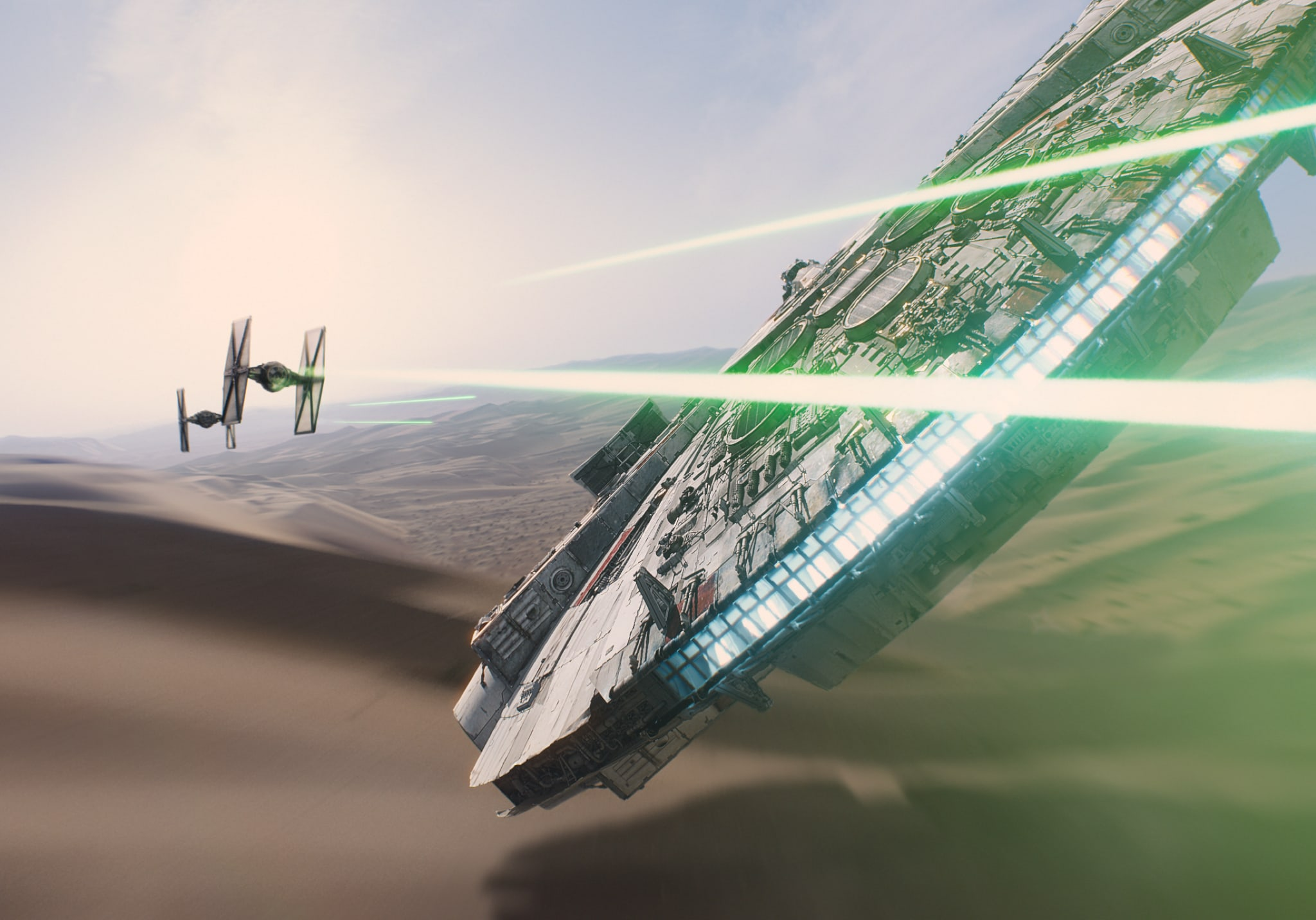 The Millennium Falcon spacecraft battles TIE fighters of the First Order.