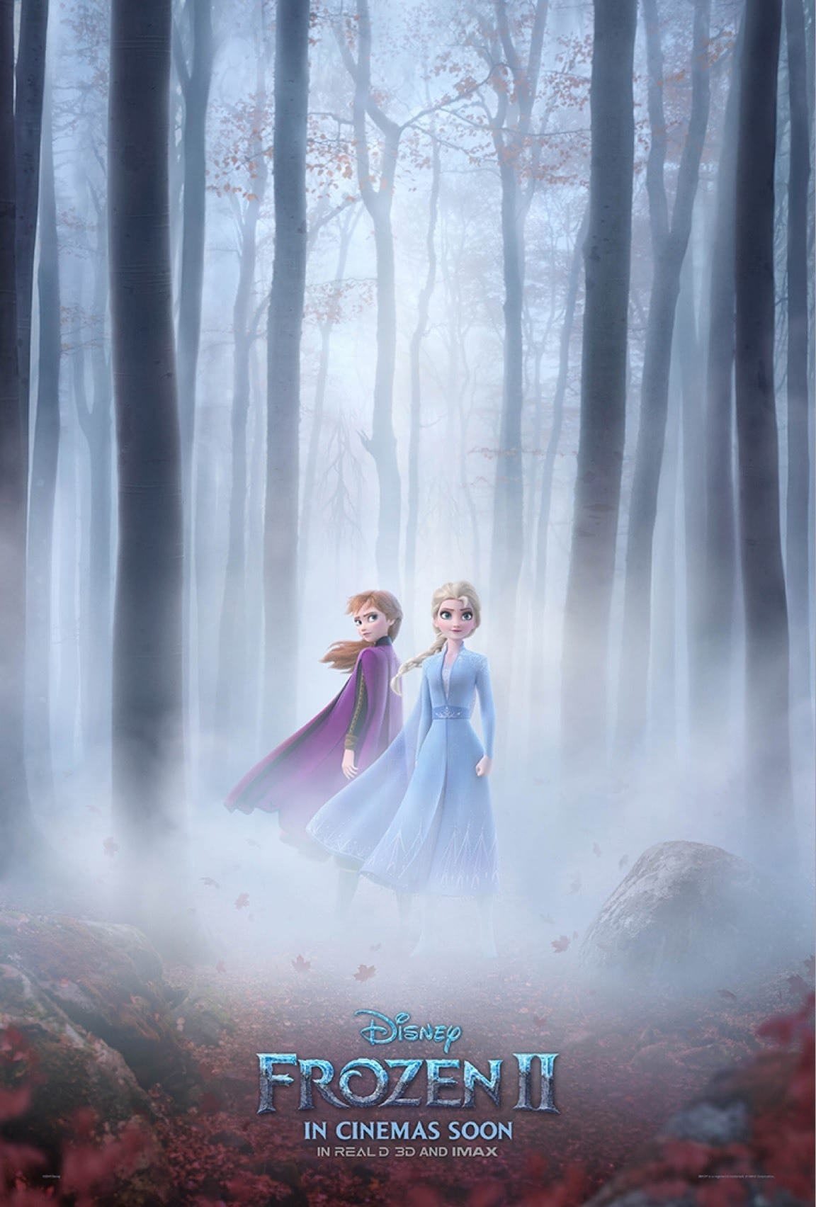 Elsa and Anna standing in a forest surounded by mist